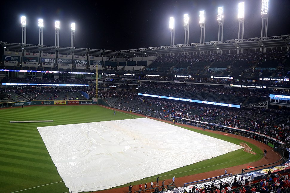 The tarp is on the field during the 10th inning of World Series Game 7. (30746057685)