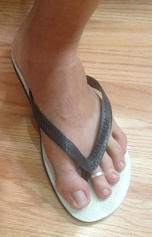 Toe ring - A toe ring being worn.