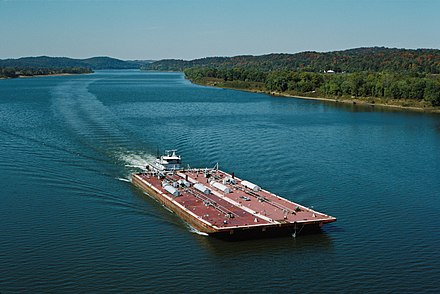 Barges are a common sight along the Ohio River. Ports of Indiana manages three maritime ports in the state, two located on the Ohio. Towboat Ben McCool upbound on Ohio River with two tank barges (1 of 6) 87j082.jpg
