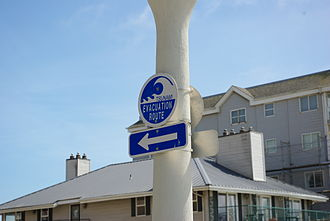 Tsunami warning system - Evacuation route sign in a low-lying coastal area on the West Coast of the United States