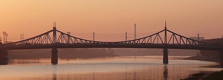 A suspension bridge (Stariy Most/Staryi Most) across the Volga in Tver (built 1897-1900, damaged during the war, repaired in 1947 and rebuilt in 1980) Tver dusk 3.jpg