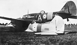 "Two Avro Ansons (L9162 and N4876) ""piggyback"" in a paddock near Brocklesby 2.jpg"