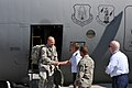 U.S. Air Force Col. John Higgins, the 107th Airlift Wing vice commander; Command Chief Master Sgt. David Wohleben and Lt. Col. Kevin Rogers, the deputy commander of maintenance, welcome home Airmen returning to 110829-F-ZP861-4637.jpg