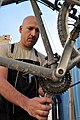 U.S. Air Force Tech. Sgt. Juan Sanchezduarte, with the 451st Expeditionary Logistics Readiness Squadron, works on a bicycle at a bike repair shop at Camp Losano, Kandahar Airfield, Afghanistan, Nov. 11, 2013 131111-F-BY961-020.jpg