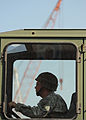 U.S. Army Pfc. Jonathan Johnson, a cargo specialist, is part of a team working the Joint Logistics Over-the-Shore (JLOTS) system to get cargo ashore in Port-au-Prince, Haiti 100208-N-HX866-006.jpg