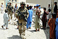 U.S. Army Sgt. Jason McIntosh, center, with Alpha Company, 1st Battalion, 143rd Infantry Regiment, Texas Army National Guard, provides security as members of Kunar Provincial Reconstruction Team (PRT) visit 120526-F-NG741-278.jpg
