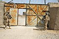 U.S. Army Spc. Joseph Reed, left, and Pfc. Carl Scott, both assigned to Charlie Troop, 3rd Brigade Combat Team, 10th Mountain Division, provide security at an exterior gate during a key leader engagement 140318-A-YK672-104.jpg