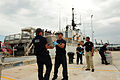 U.S. Coast Guardsmen from USCGC Tahoma (WMEC 908) unload bales of cocaine at Base Support Unit Miami, Fla., Aug. 23, 2010 100823-G-ZE884-038.jpg