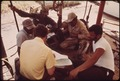 U.S. INTERIOR DEPARTMENT OFFICIAL MEETS WITH OYSTER BOAT CAPTAINS AT POINTE A LA HACHE TO MAP NEW NAVIGATIONAL CHARTS... - NARA - 548277.tif