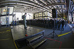 U.S. Navy Capt. Greg Fenton, the commanding officer of the aircraft carrier USS George Washington (CVN 73), addresses crew members during an all-hands call in the ship's hangar bay Jan. 3, 2014, in Yokosuka 140103-N-BX824-026.jpg