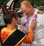 U.S. Navy Capt. Tim Hinman, right, the commanding officer of the medical treatment facility aboard Military Sealift Command USNS Mercy (T-AH 19), is greeted with a traditional welcome on the island of Siau 120605-N-GI544-010.jpg