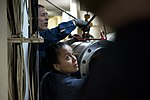 U.S. Navy Gas Turbine System Technician (Electrical) 2nd Class Rosa MoranVazquez helps move propulsion equipment into a machinery room during maintenance activities aboard the guided missile destroyer USS 140308-N-WD757-153.jpg