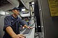 U.S. Navy Gas Turbine System Technician (Mechanical) 3rd Class Russel Kates, assigned to the guided missile cruiser USS Antietam (CG 54), monitors a control console in one of the ship's main engine spaces 131002-N-TG831-098.jpg