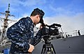 U.S. Navy Mass Communication Specialist 2nd Class Dustin Sisco documents the departure of the guided missile destroyer USS Russell (DDG 59) at Joint Base Pearl Harbor-Hickam, Hawaii 130103-N-RI884-022.jpg