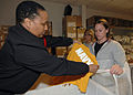 U.S. Navy Store Keeper 1st Class Erika Teasley, left, issues new physical training uniforms to Recruit Jennifer DuFour, as she processes in at the Recruit Training Command, Great Lakes, Ill., April 30, 2008 080430-N-IK959-074.jpg