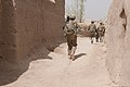 U.S. Soldiers with the 1st Battalion, 5th Infantry Regiment, 1st Stryker Brigade Combat Team, 25th Infantry Division maneuver through a village while on an Afghan-partnered foot patrol in Panjwai district 120401-A-VQ566-686.jpg
