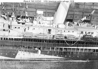 USS America (ID-3006) - The damaged port side of the USS America