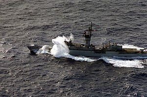 USS Badger (FF-1071) - Badger in heavy seas in 1985.
