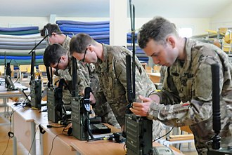 United States Army Reconnaissance and Surveillance Leaders Course - Students practice setting up their radios prior to their communication hands-on test at the RSLC