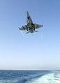 US Navy 021014-N-6817C-005 F-A-18 Hornet makes arrested landing aboard a carrier at sea.jpg