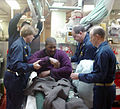 US Navy 030108-N-2338M-004 Medical personnel treat a fisherman after his vessel sank due in rough seas near Bermuda.jpg