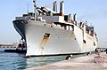 US Navy 040226-N-0743B-026 Tugboats ease the Military Sealift Command (MSC) fast sealift ship USNS Bellatrix (T-AKR 288) into the port of Mina Ash-Shu'aibah, Kuwait.jpg