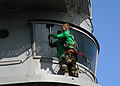US Navy 040319-N-6433N-032 Airman George Henry, of Savannah, Ga., cleans the window covering the Pilot Landing Air Television (PLAT) camera aboard USS George Washington (CVN 73).jpg