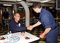 US Navy 041202-N-6781S-068 Actor Craig T. Nelson, shakes the hand of Fireman Mike Smith of Beverton, Ore., after signing an autograph in the mess decks aboard the aircraft carrier USS Nimitz (CVN 68).jpg