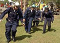 US Navy 050107-N-9293K-062 U.S. Navy personnel rush to put an injured Indonesian citizen on a stretcher after a Navy helicopter medically evacuated them at Sultan Iskandar Muda Air Force Base in Banda Aceh, Sumatra Indonesia.jpg