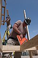 US Navy 050303-N-6027E-001 Builder 2nd Class Michael Woodall and Builder 2nd Class William Lathn build an eight-man permanent living space at Camp Morreel on Ali Al Salem Air Base, Kuwait.jpg