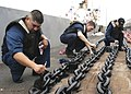 US Navy 050504-N-9293K-021 Sailors assigned to the deck department aboard the guided missile frigate USS Ford (FFG 54) paint an anchor chain while in port at Naval Station Everett.jpg