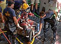 US Navy 050911-N-5345W-087 U.S. Navy Sailors assigned to Mobile Diving and Salvage Unit Two (MDSU-2), Detachment Two, work together to thoroughly clean and sanitize a diver immediately after completing dive operations.jpg