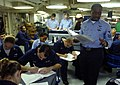 US Navy 051024-N-9742R-004 Air Traffic Controller 1st Class Ronald Young, of Detroit, Mich., explains aircraft handling procedures during Enlisted Air Warfare Specialist (EAWS) training held on the mess decks of the nuclear-pow.jpg
