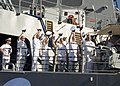 US Navy 070126-N-1280S-010 A group of chiefs aboard guided missile destroyer USS O'Kane (DDG 77), wave to friends and family as they prepare to get underway.jpg