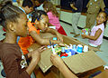 US Navy 070516-N-7653W-056 Students help each other carefully place items, such as toothpaste, mouthwash and other things the children collected into a box at the Betty Williams School in Norfolk.jpg