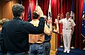 US Navy 070820-N-3271W-003 Rear Adm. Gerald R. Beaman, commander of Strike Force Training Pacific, conducts an oath of enlistment for six new recruits at the Military Entrance Processing Station.jpg
