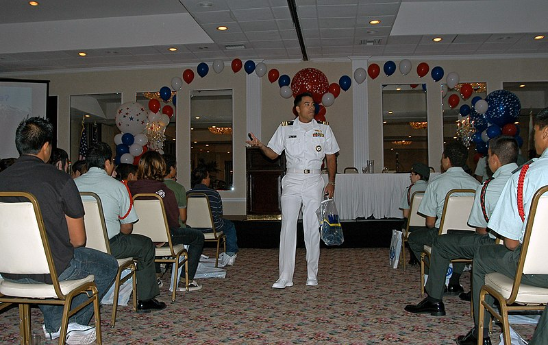 File:US Navy 071012-N-7029R-059 Lt. Cmdr. Anthony Bayungan, programs officer, explains Navy programs and benefits to cadets from Junior Reserve Officer's Training Corps (JROTC).jpg