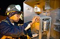 US Navy 071106-N-0775Y-015 Construction Electrician 3rd Class Rodnesha Rodriguez, a Seabee attached to Naval Mobile Construction Battalion (NMCB) 3 checks the viscosity of a mud sample during water well drilling operations on b.jpg