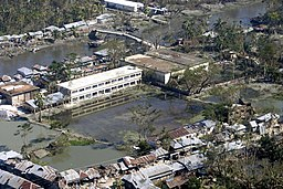 US Navy 071120-M-8966H-005 An aerial view over southern Bangladesh reveals extensive flooding as a result of Cyclone Sidr