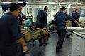 US Navy 071206-N-7987H-059 Sailors attached to Fleet Surgical Team (FST) 2 assist Marines from the 24th Marine Expeditionary Unit during a simulated mass casualty drill aboard the amphibious assault ship USS Nassau (LHA 4).jpg