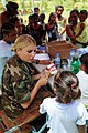 US Navy 080817-N-7955L-141 Senior Airman Alexandra Olson, embarked aboard the amphibious assault ship USS Kearsarge (LHD 3), teaches children how to properly brush their teeth at the Betania medical clinic.jpg