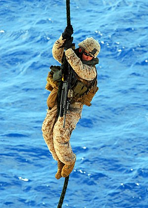 Fast-roping - Marine using his feet while fast-roping