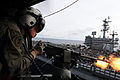 US Navy 081121-N-3659B-202 Naval Aircrewman 2nd Class Keith Holt fires blank rounds from an M-240 machine gun from an SH-60F Seahawk helicopter assigned to the.jpg