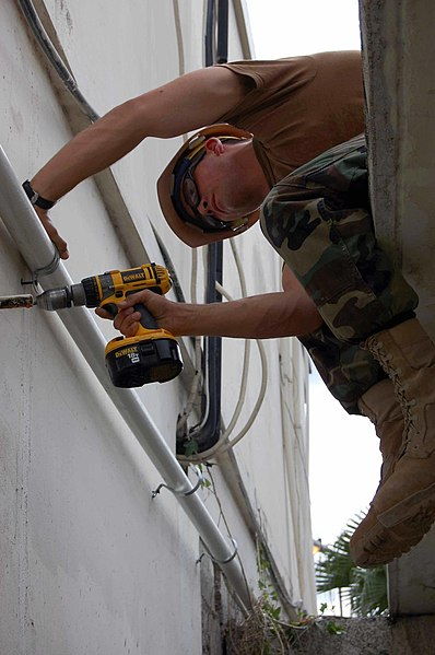 File:US Navy 090422-F-5647K-006 Construction Electrician 3rd Class Kyle Nixon works to expand the Dominican Republic's National Reference Laboratory.jpg