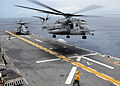 US Navy 090504-N-9950J-141 Aviation Boatswain's Mate (Handling) Seaman Emily McCann, of Redlands, Calif., and Aviation Boatswain's Mate (Handling) 3rd Class Lois Braxton, of Brooklyn, N.Y., direct the launch of a CH-53E Sea Sta.jpg