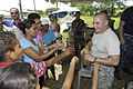 US Navy 090712-F-7923S-018 Staff Sgt. Fernando Cuba, a satellite system operator aboard the Military Sealift Command hospital ship USNS Comfort (T-AH 20), hands out various medical ointments and other products to patients.jpg