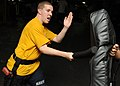 US Navy 100203-N-5538K-162 Fire Controlman 3rd Class Robert L. Keith, left, defends himself from Seaman Jakravitz J. Tunstall with a padded baton during naval security force sentry training aboard the forward-deployed amphibio.jpg