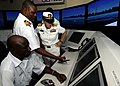 US Navy 100308-N-7948C-260 Capt. Cindy Thebaud, commander of Africa Partnership Station (APS) West, tours a navigation simulator at the Joint Maritime Training Center at Nigeria Naval Station Quorra.jpg