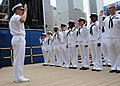 US Navy 100527-N-3237D-168 Rear Adm. Mark Bonsel, commander of U.S. Navy Mid-Atlantic Region, reenlists Sailors from various commands at the site of the World Trade Center during Fleet Week New York 2010.jpg