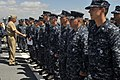 US Navy 100609-N-8273J-037 Chief of Naval Operations (CNO) Adm. Gary Roughead congratulates newly-frocked petty officers before an all-hands call aboard the Arleigh Burke-class Destroyer USS Hopper (DDG 70) at Joint Base Pearl.jpg